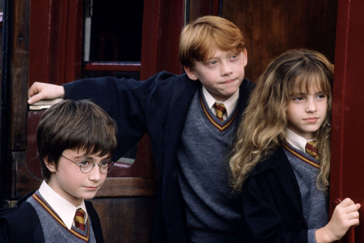 "Harry Potter (Daniel Radcliffe, left), Ron Weasley (Rupert Grint, center) and Hermione Graner (Emma Watson) in ""Harry Potter and the Sorcerer's Stone"" in 2001."