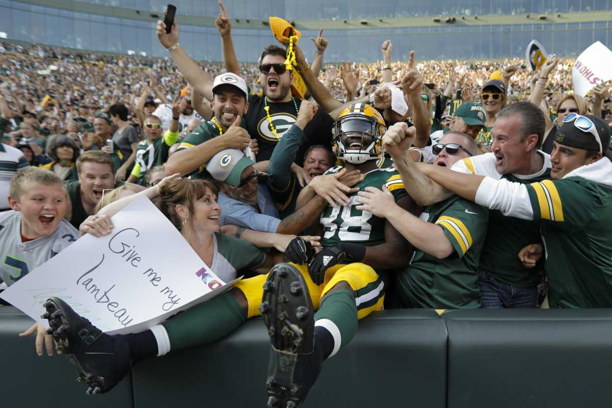 Green Bay Packers' Ty Montgomery celebrates his touchdown run with fans during the second half of an NFL football game against the Seattle Seahawks Sunday, Sept. 10, 2017, at Lambeau Field in Green Bay, Wis.