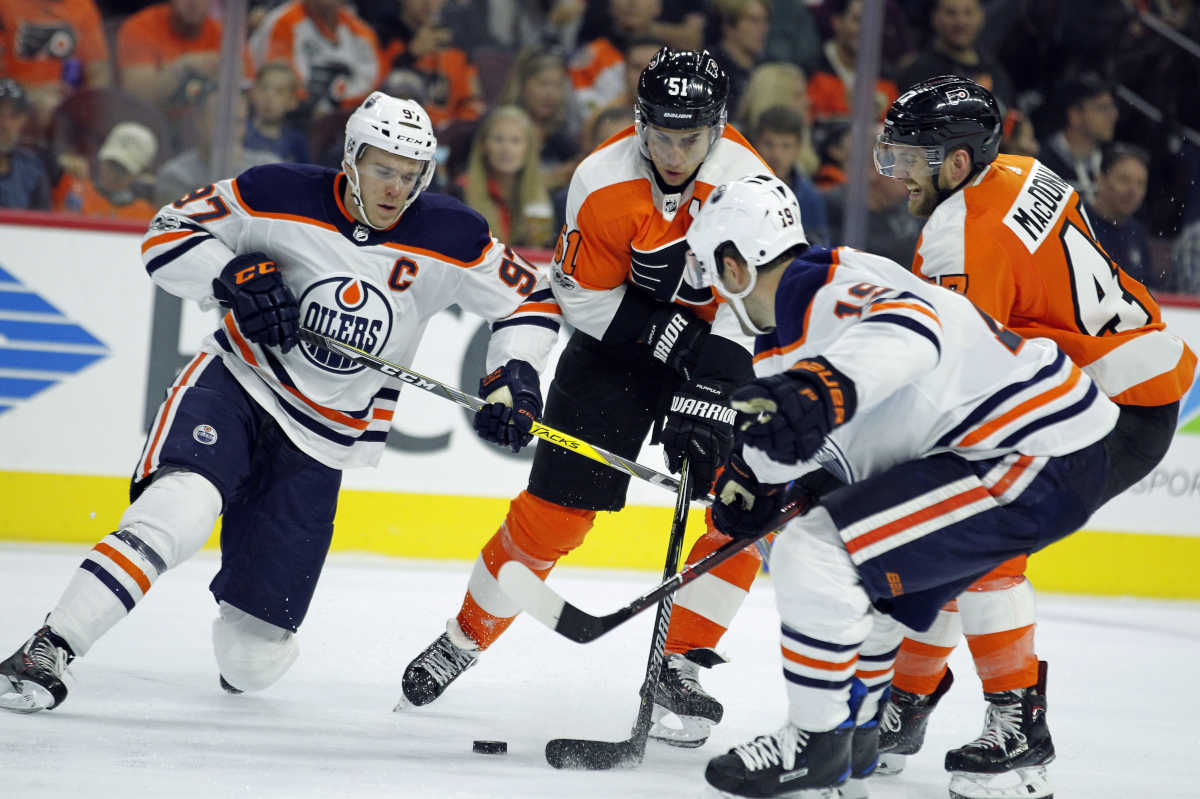 Edmonton Oilers' Connor McDavid, Philadelphia Flyers' Valtteri Filppula, Oilers' Patrick Maroon anbd Flyers' Andrew MacDonald, battle for control of the puck during the second period of an NHL hockey game against the , Saturday, Oct. 2119, 2017, in Philadelphia.