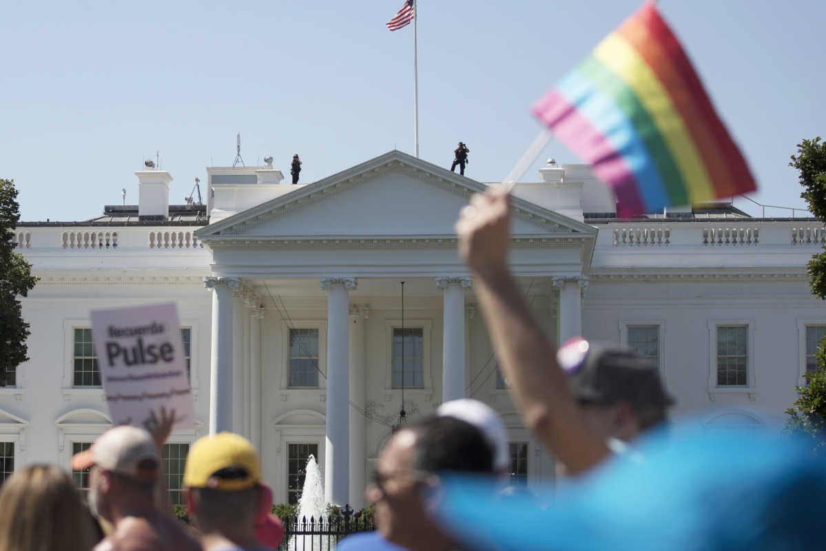 Equality March for Unity and Pride participants march past the White House in June.