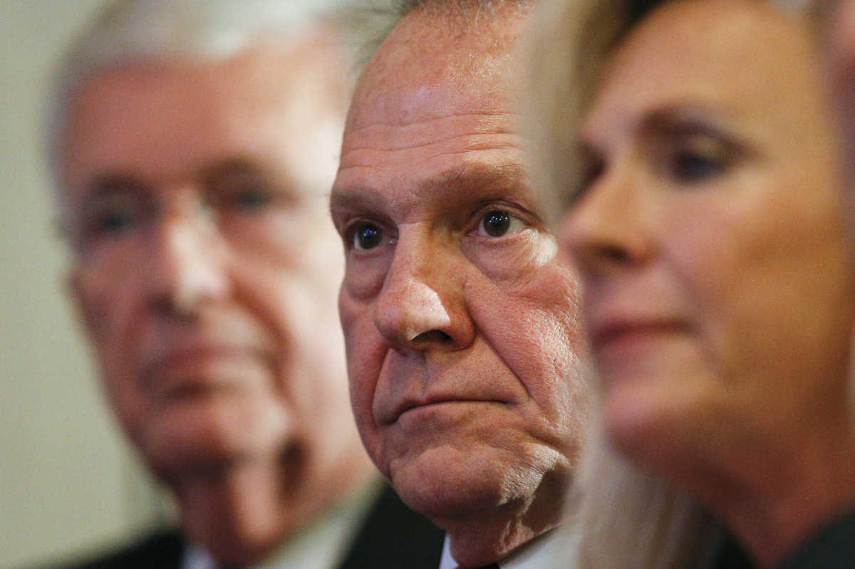 Former Alabama Chief Justice and U.S. Senate candidate Roy Moore waits to speak at a news conference Thursday in Birmingham, Ala.