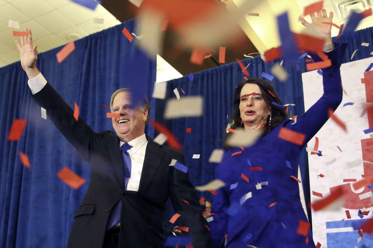 Democrat Doug Jones and his wife, Louise, celebrate his victory in Tuesday's special Senate election in Alabama.