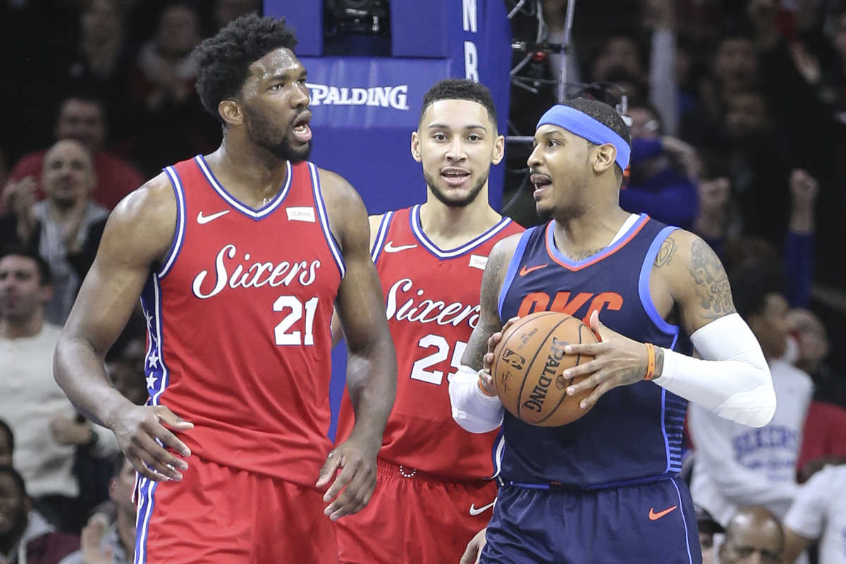 Sixers' Joel Embiid has words with Thunder's Carmelo Anthony with Ben Simmons in the middle during the third quarter at the Wells Fargo Center in Philadelphia, Friday, Dec. 15, 2017. The Thunder beat the Sixers in triple overtime, 119-117.