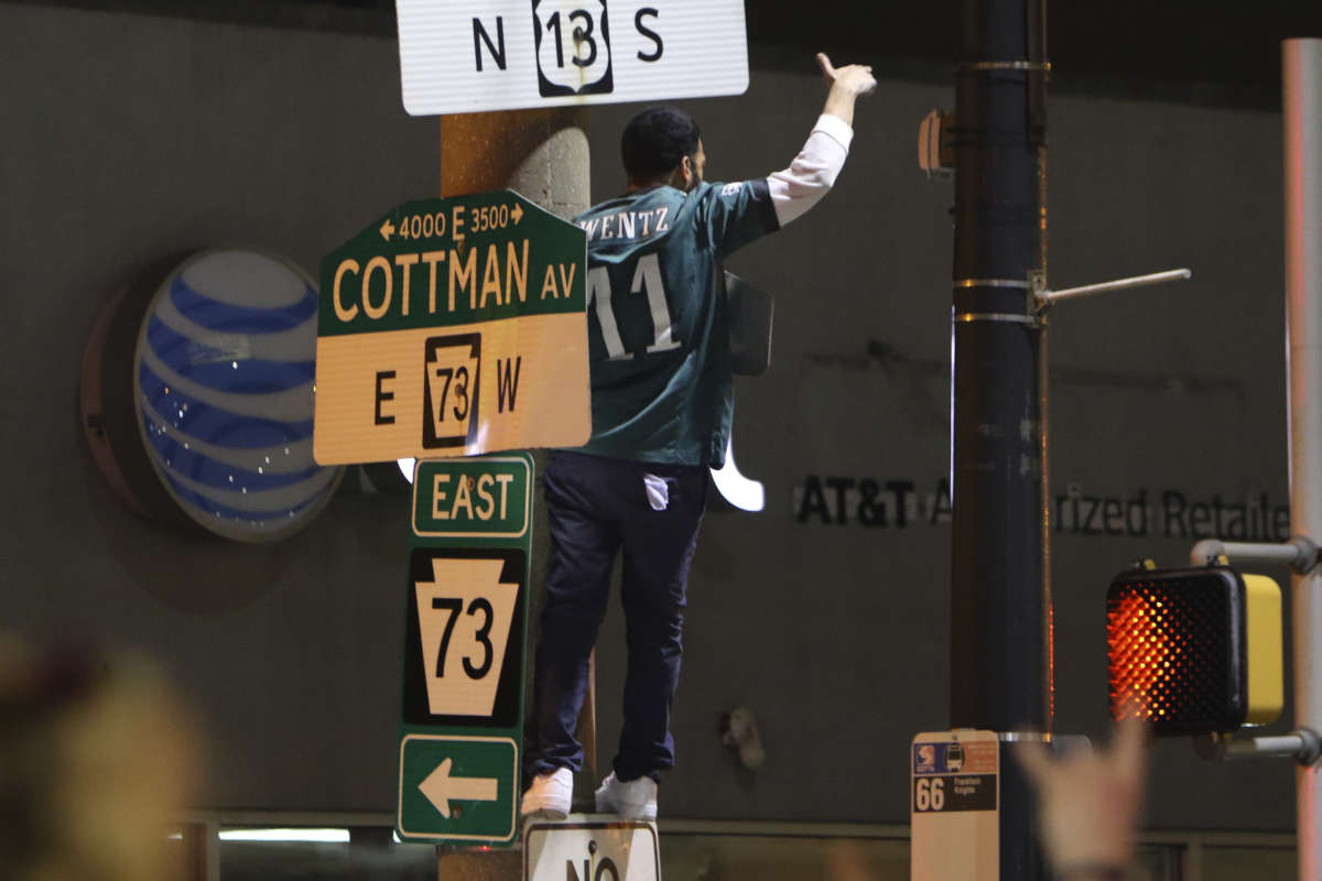 Fan celebrate in the street at Cottman Avenue and Frankford Avenue in the Mayfair section of Northeast Philadelphia, Sunday Jan. 21, 2018, following the Eagles win over the Minnesota Vikings during the NFC Championship game.