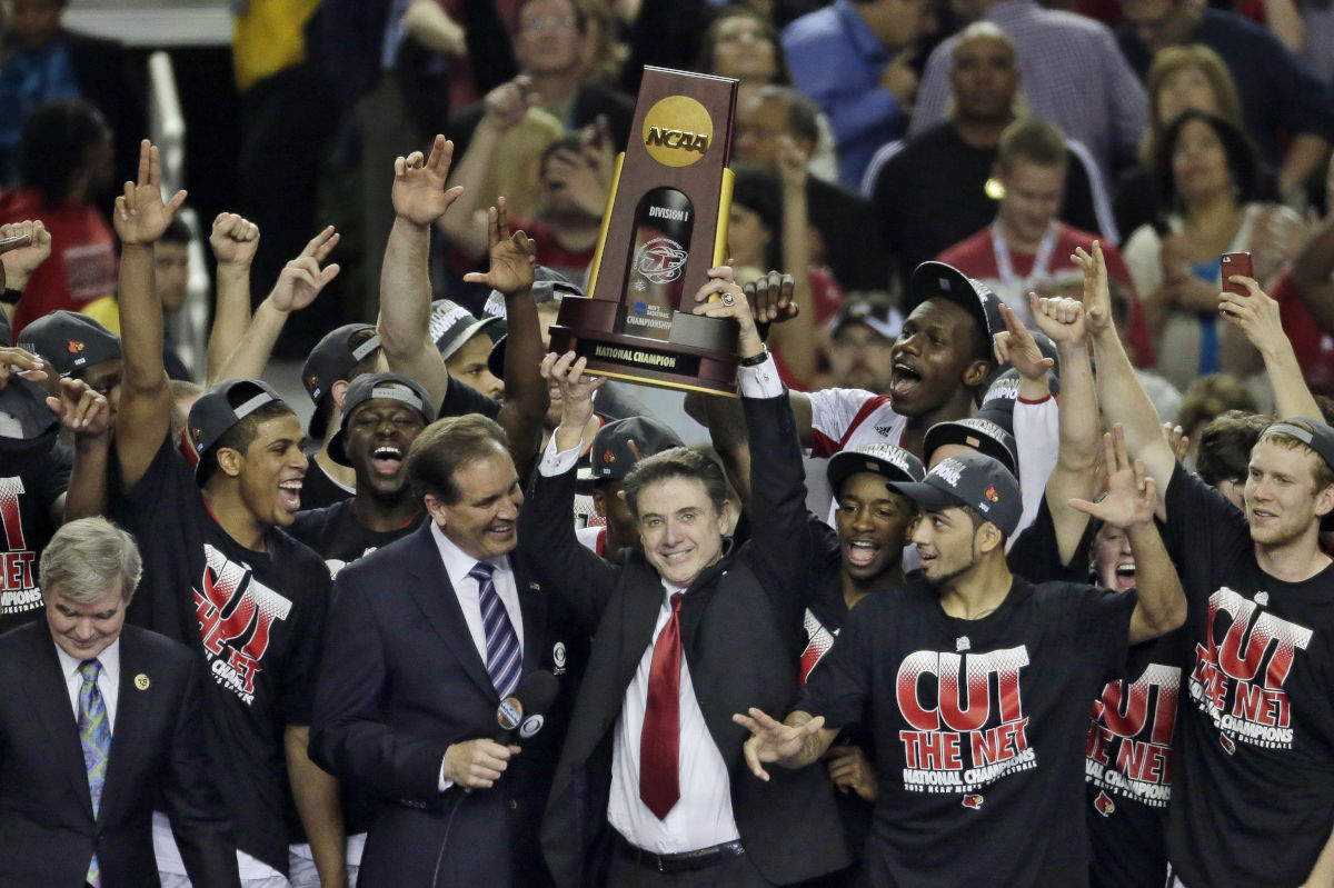 n this April 8, 2013, file photo, Louisville players and head coach Rick Pitino celebrate after defeating Michigan 82-76 in the championship of the Final Four in the NCAA college basketball tournament in Atlanta.