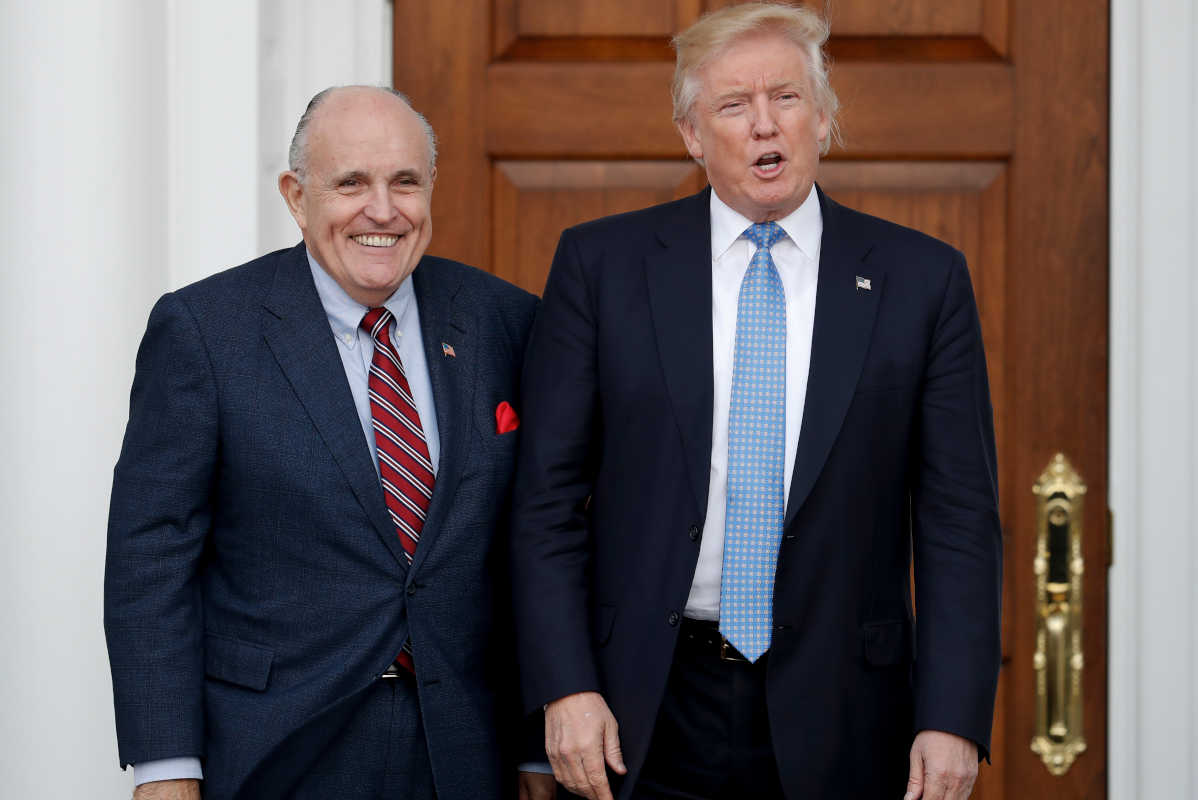 Then-President-elect Donald Trump (right) and former New York Mayor Rudy Giuliani in a 2016 file photograph.