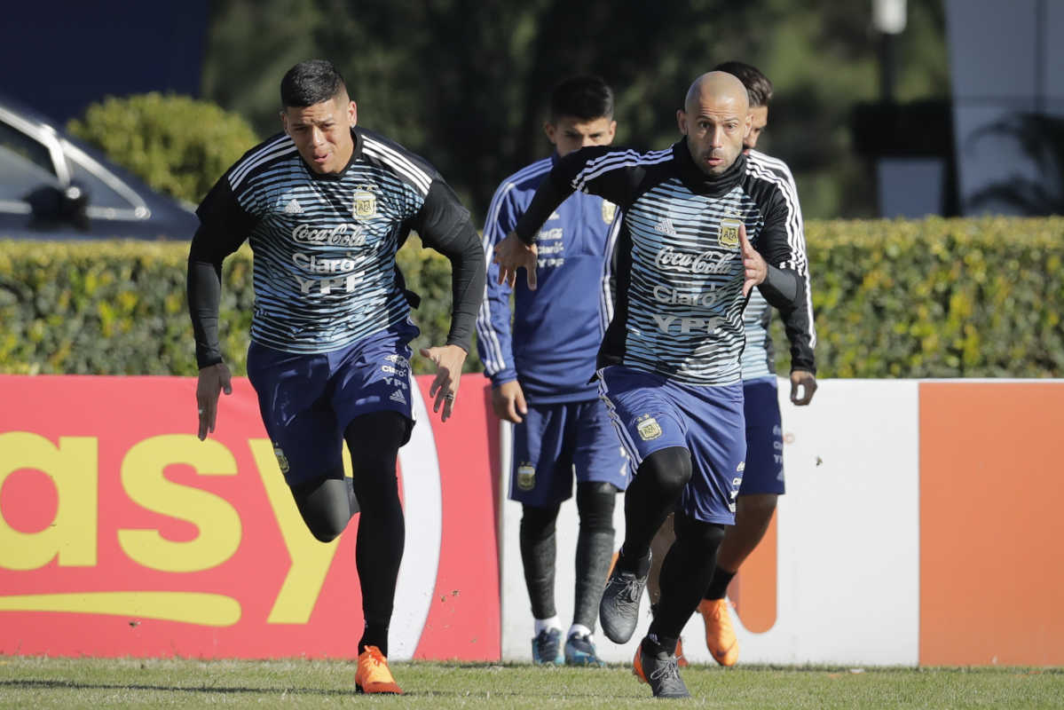 Javier Mascherano (right) and Marcos Rojo attend a training session with the Argentine national soccer squad in Buenos Aires, Argentina, Wednesday, May 23, 2018. Argentina will face Haiti on May 29 in an international friendly soccer match ahead of the FIFA Russia World Cup.
