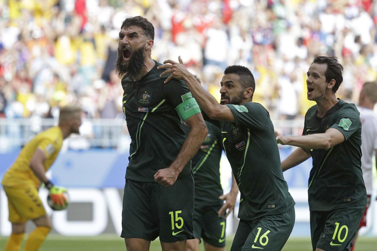 Australia's Mile Jedinak celebrates after scoring against Denmark.