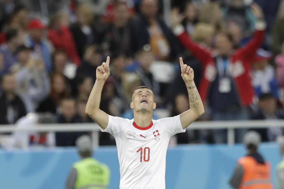 Switzerland's Granit Xhaka celebrates after scoring against Serbia.