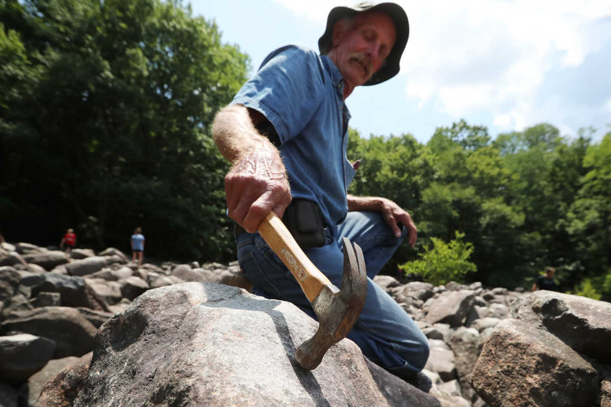 Raymond Graven, 63, Pullman, Alabama, explores the ringing rocks of Upper Black Eddystone Thursday July 12, 2017.