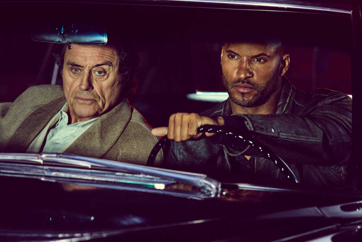 """Ian McShane (left) as  Mr. Wednesday and Ricky Whittle as Shadow Moon in """"American Gods."""""""