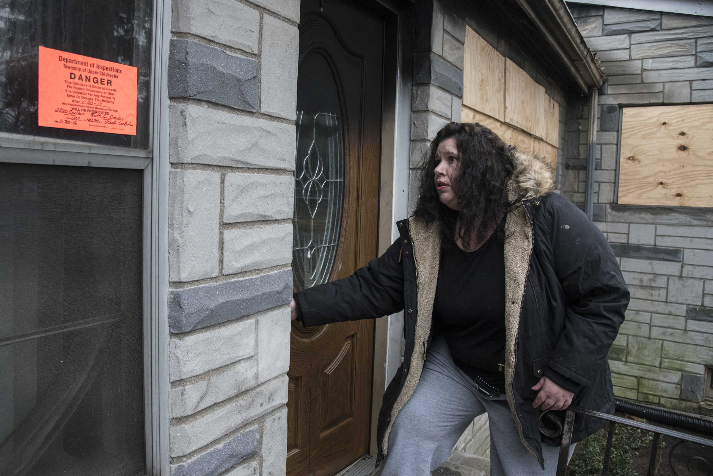 Tiffany Wilson Lane, 42, enters her burned out home in Ogden, PA February 12, 2017.