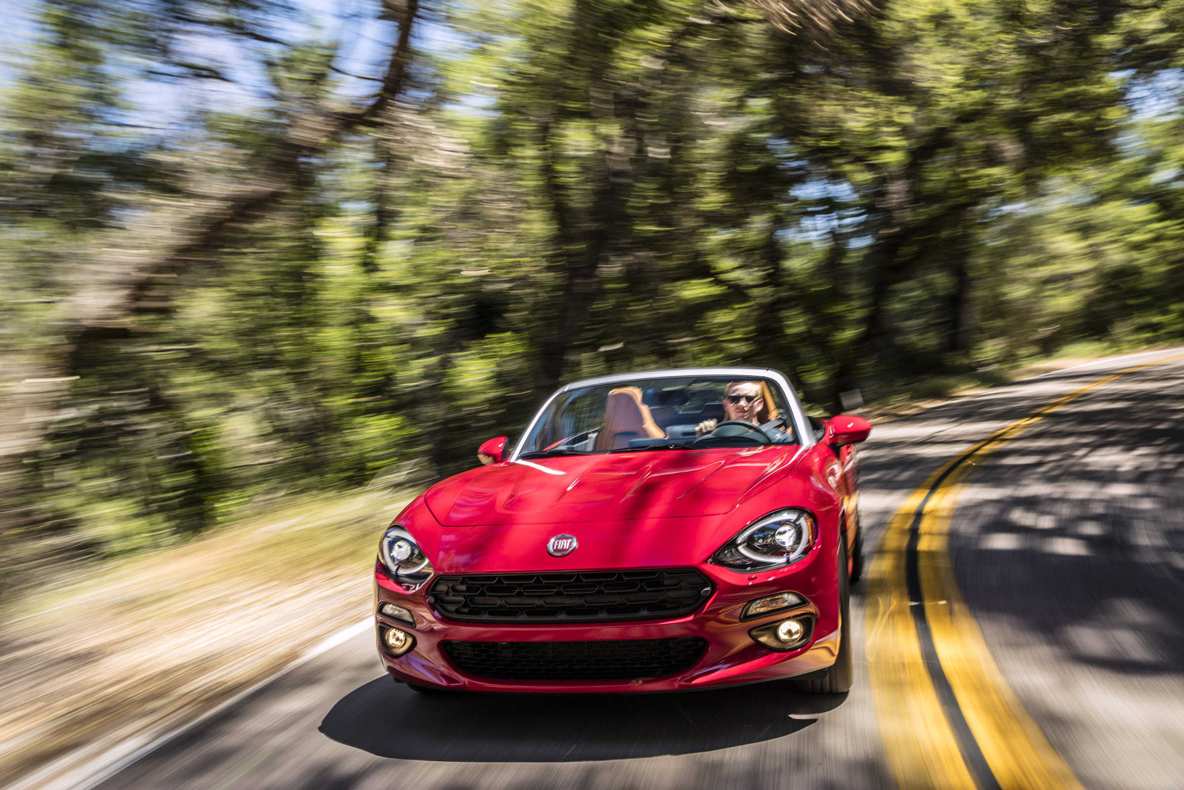 The 2017 Fiat 124 Spider Lusso shares a lot of traits of the Mazda MX-5 Miata, but supercharges them.
