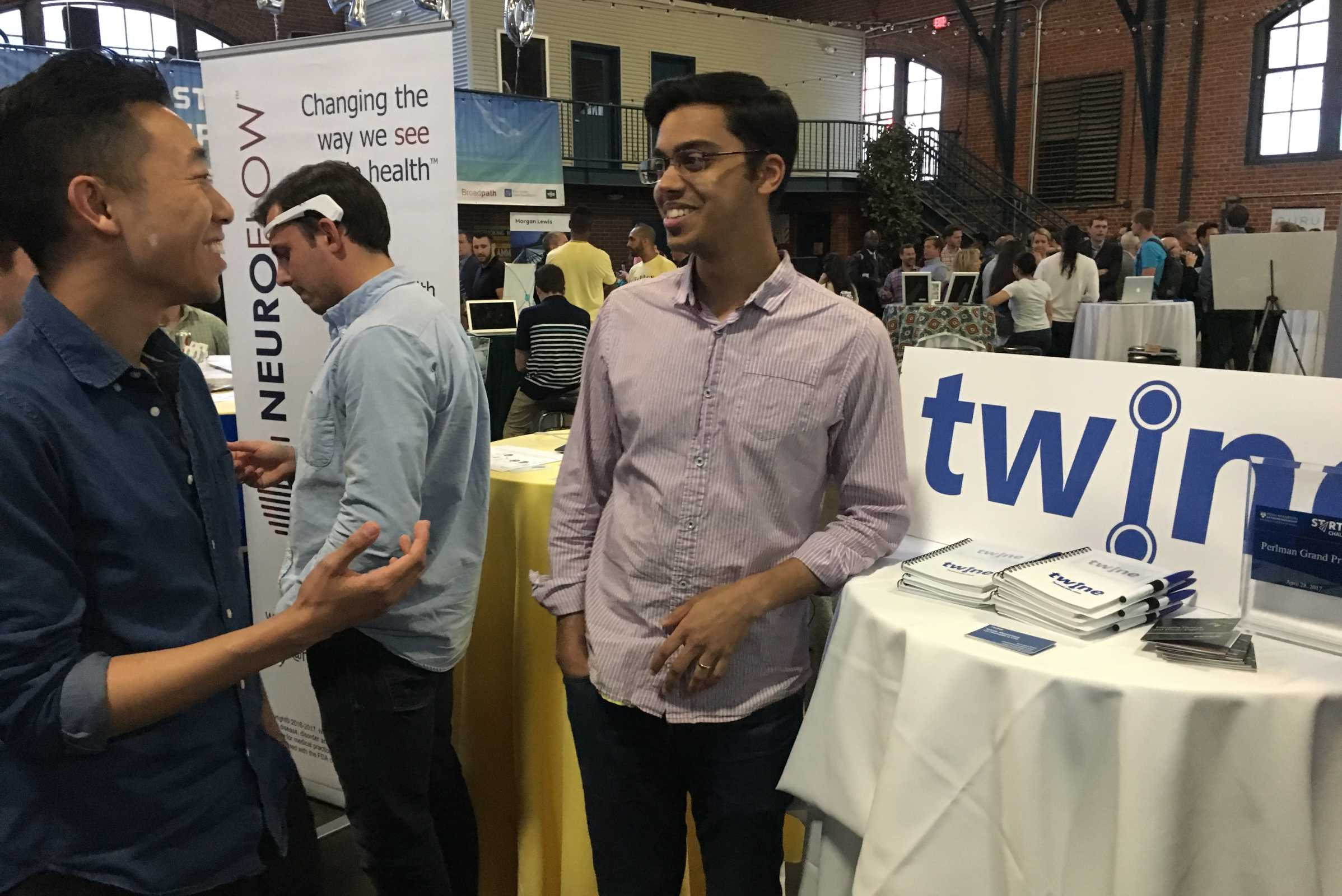 Joseph Quan (left) and Nikhil Srivastava took first place in the Penn Wharton Startup Showcase with Twine, their algorithmic solution for keeping employees engaged by moving them into more fulfilling new jobs.