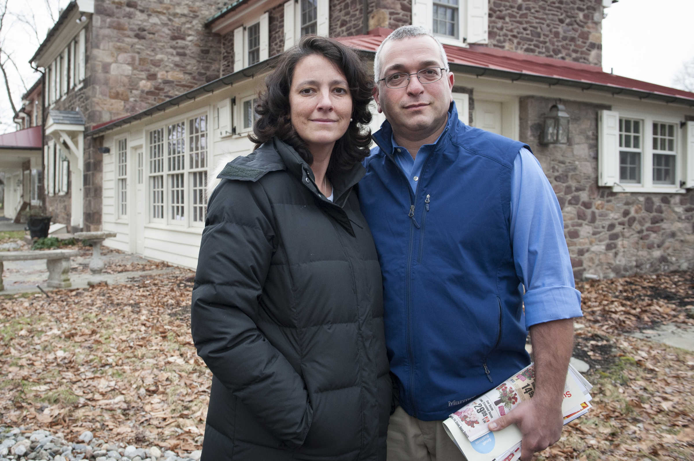 Dr. Amy Reed and her husband, Dr. Hooman Noorchash, in front of their home on Feb. 4, 2016. Her family is seeking to have her body buried in Washington Crossing National Cemetery.