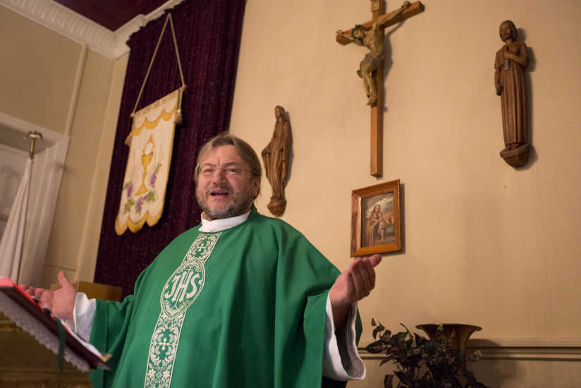 Rev. Krzysztof Wtorek, of St. Joseph's (Polish) Church in Camden, celebrates morning Mass Friday at the church in the city's Whitman Park section. St. Joe's will become part of the Cathedral of the Immaculate Conception downtown.