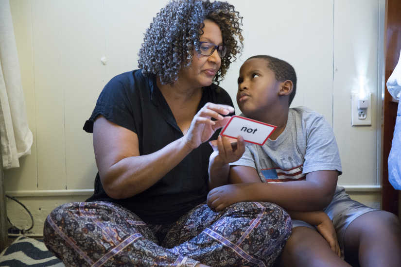 Avril Absolum works on flash cards with her son Jalen, October 5, 2016, in Philadelphia.