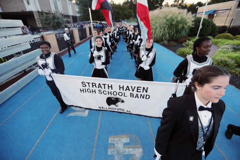 Over 400 members of Strath Haven High School's marching band take the field during an away game at Springfield High School Friday September 15, 2017.