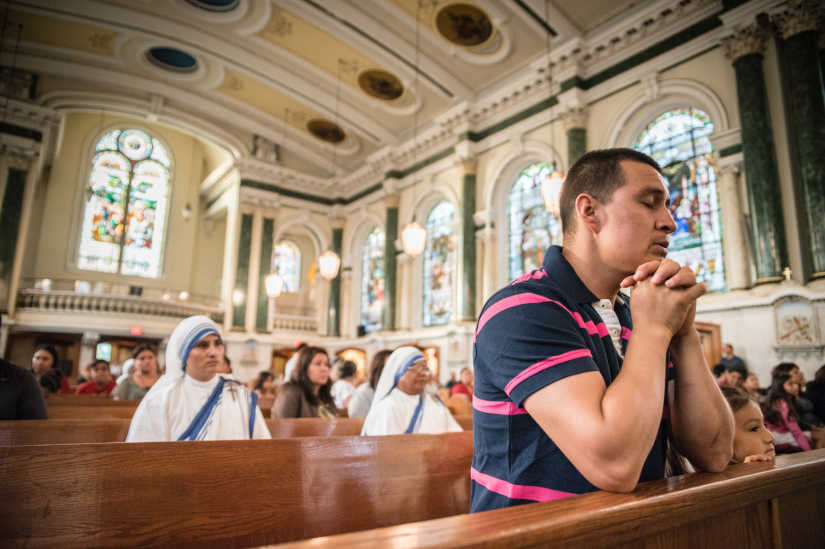 Jose Gomez prays before a special Mass for earthquake and hurricane victims Thursday, Sept. 21, 2017, at St. Patrick Church in Norristown. Gomez has relatives who live outside Mexico City, and they have been reported safe.