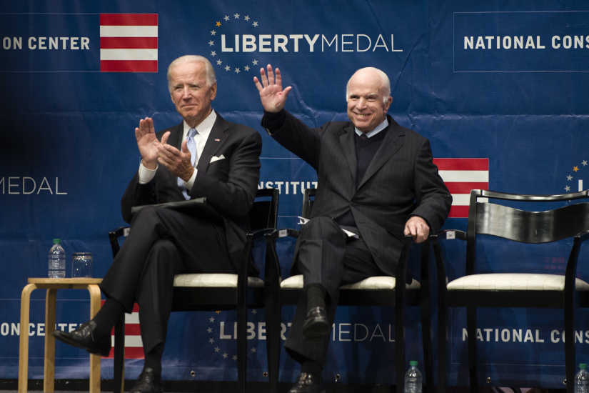Sen. John McCain is on stage with former Vice President Joe Biden (left) before receiving the Liberty Medal at the National Constitution Center October 16, 2017.