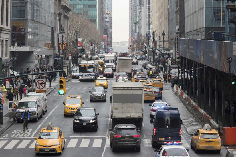 In this Jan. 11, 2018, file photo, traffic makes its way across 42nd Street in New York City. Motorists would have to shell out $11.52 to drive into the busiest parts of Manhattan under a new proposal commissioned by Gov. Andrew Cuomo to ease traffic congestion and raise vital funds for mass transit.