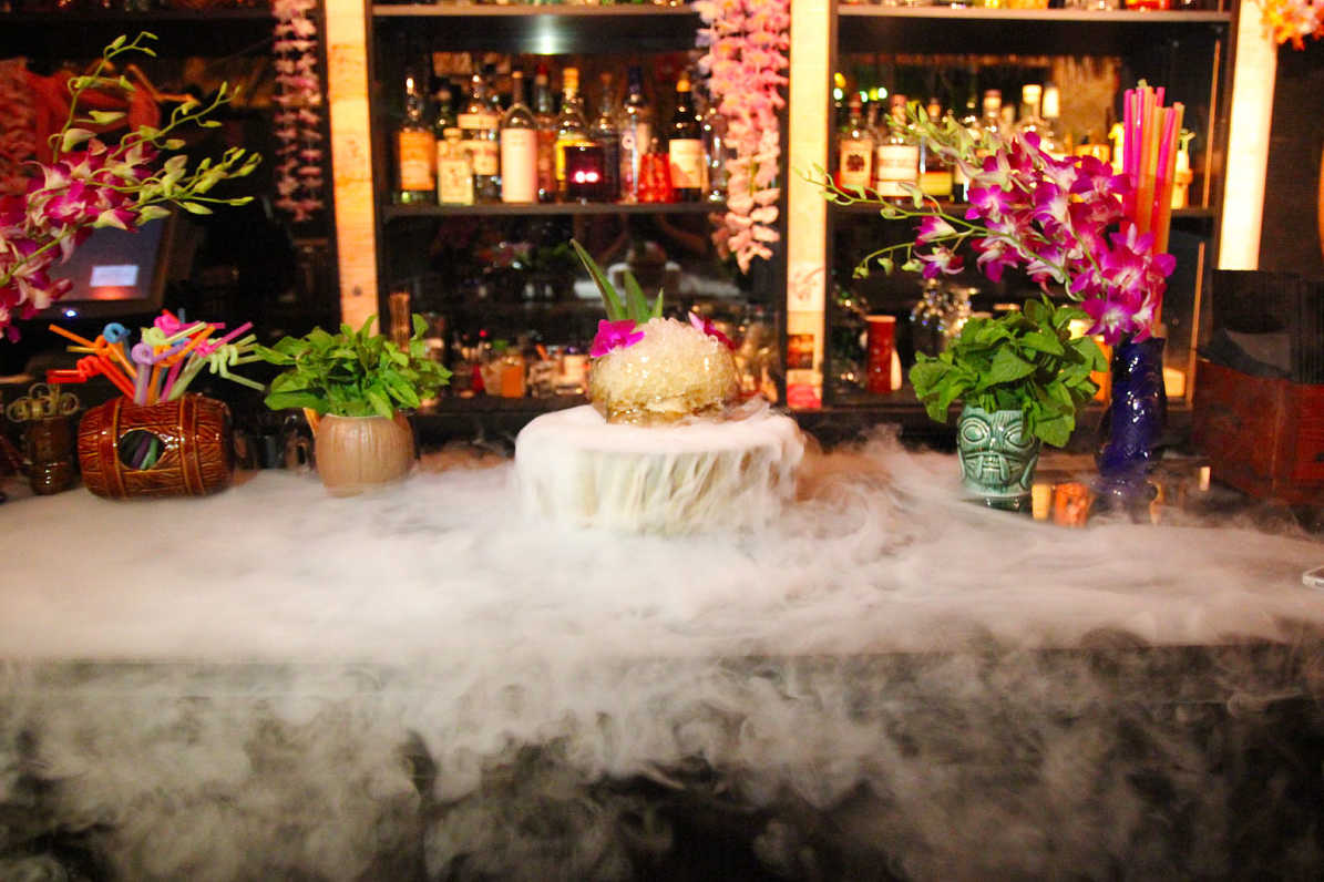 Legends of the Hidden Temple, a rum-based drink, steams with dry ice at the tiki bar upstairs at The Franklin, 112 S. 18th St.
