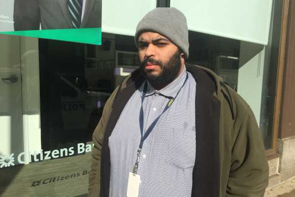 Zahir Riley, standing outside the Citizens Bank branch at Seventh and Market Streets in Center City, just found out that he will not be able to pay bills Friday because of a problem at a company that processes transactions for Citizens.