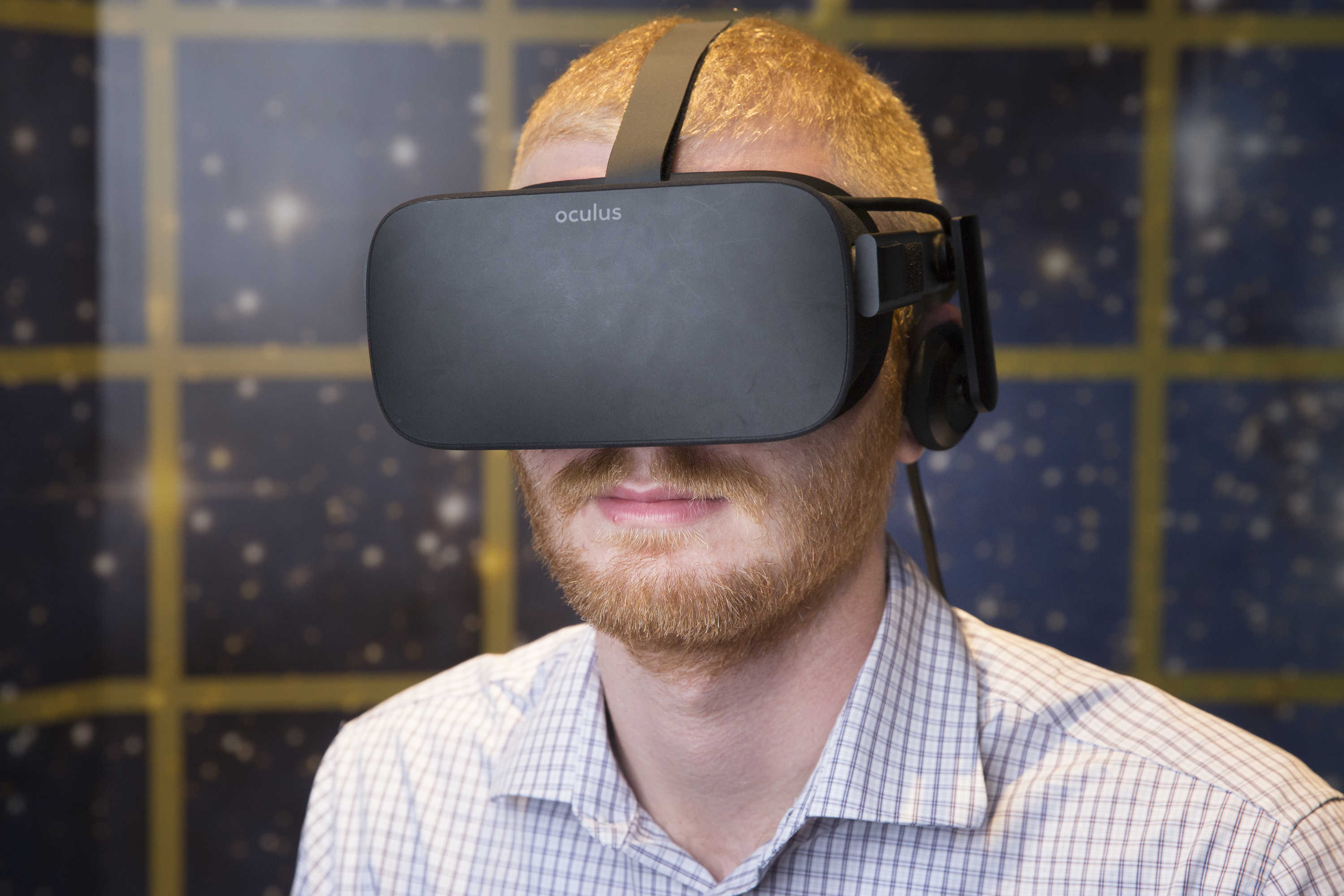 Dane Allison, development operations assistant, tries out the Oculus Rift Virtual Reality Head Mounted Display.