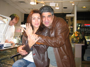 Regina and Pastore displaying her engagement ring in happier times