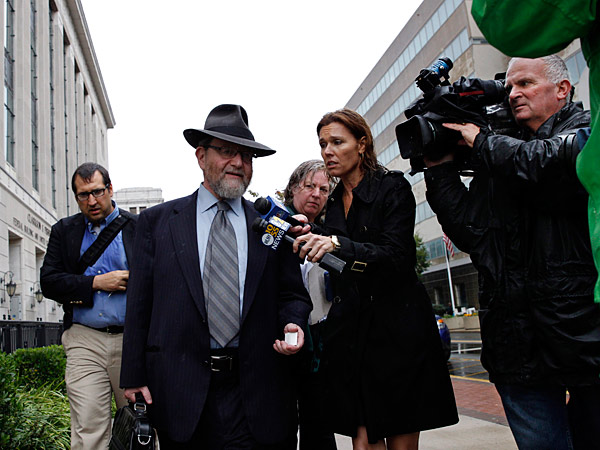 Attorney Jacob Laufer, who represents Ariel Potash, answers questions as he leaves federal court in Trenton, N.J., Thursday, Oct. 10, 2013, after a judge ordered two rabbis and eight associates held in federal custody after being accused of plotting to kidnap and torture a man to force him to grant a religious divorce. (AP Photo/Mel Evans)