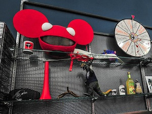 A shelf of collectibles stands tall in the RevZilla kitchen area, located at 4020 S. 26th St., in Philadelphia, Pa. (Jessie Fox / Philly.com)
