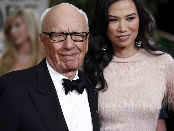 Rupert Murdoch and his wife Wendi arrive at the 69th Annual Golden Globe Awards in Los Angeles. Murdoch  filed Thursday, June 13, 2013, for divorce from Wendi Deng Murdoch, his wife since 1999.(AP Photo/Matt Sayles, File)