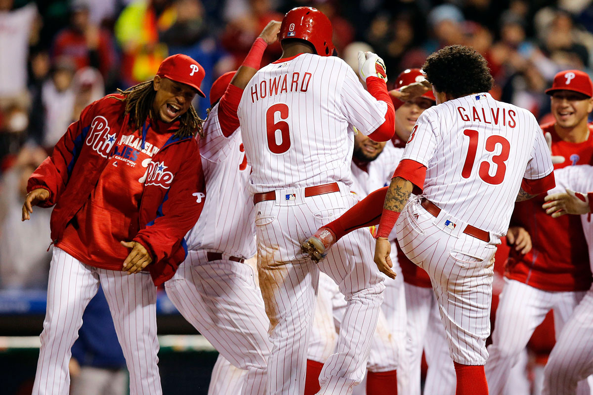 The Phillies´ Ryan Howard celebrates his game-winning 11th-inning solo home run with his teammates against the Cleveland Indians on Friday, April 29, 2016.