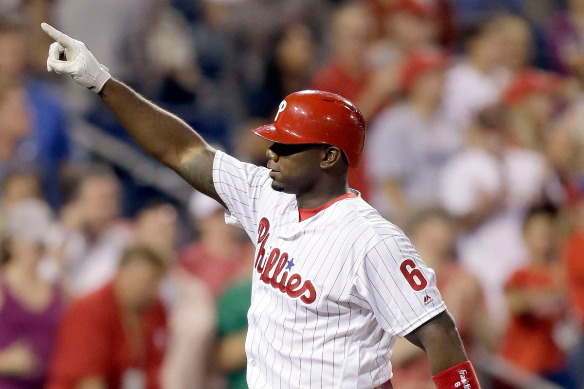 Ryan Howard celebrates a grand slam against the Rockies.