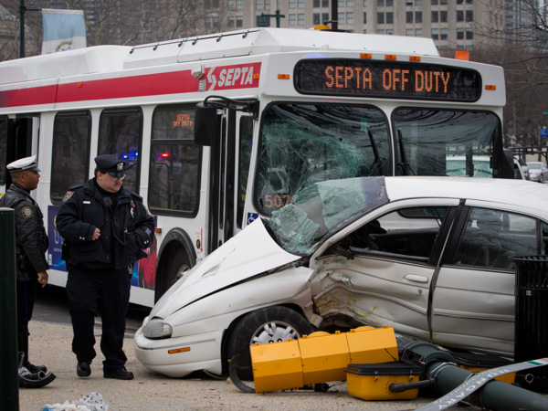 Philadelphia and SEPTA police at the scene of an accident today, April 7, 2014, involving a bus and car at N. 22nd and Ben Franklin Parkway. ( ALEJANDRO A. ALVAREZ / STAFF PHOTOGRAPHER )