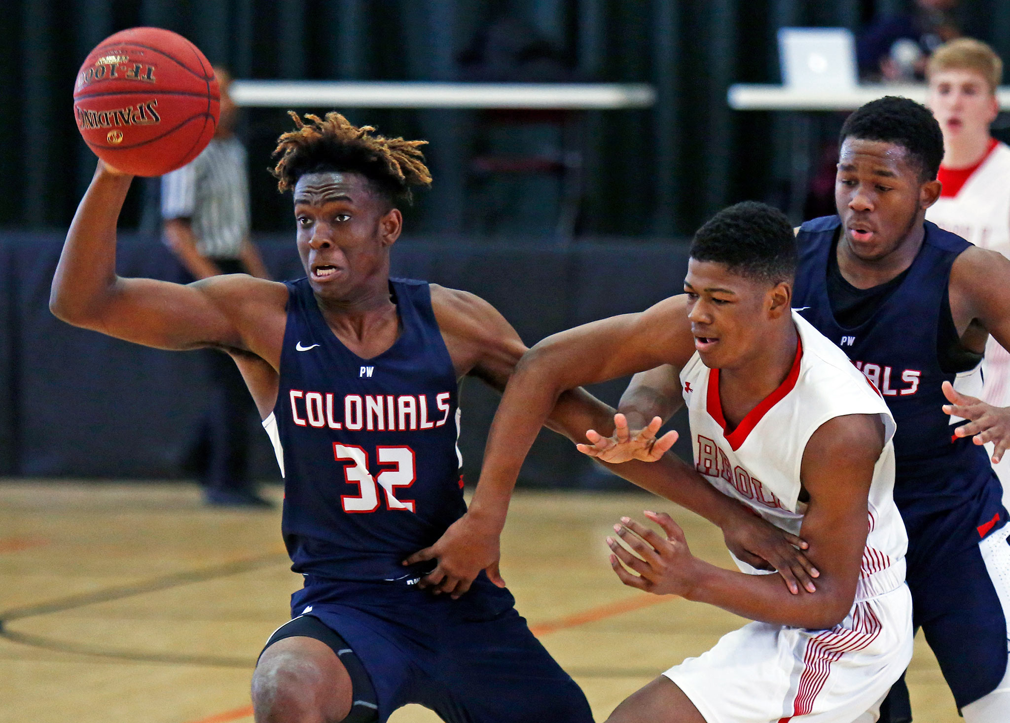 Plymouth Whitemarsh's Alan Glover (32) comes away with the ball after he and the Colonials' Ahmin Williams (right) double-teamed Archbishop Carroll's Ny'Mire Little during the first quarter of a game in the Diane Mosco Foundation Shootout Against Cancer boys' basketball showcase Saturday, Dec. 16, 2017, at Archbishop Wood. PW went on to win, 66-53. LOU RABITO / Staff