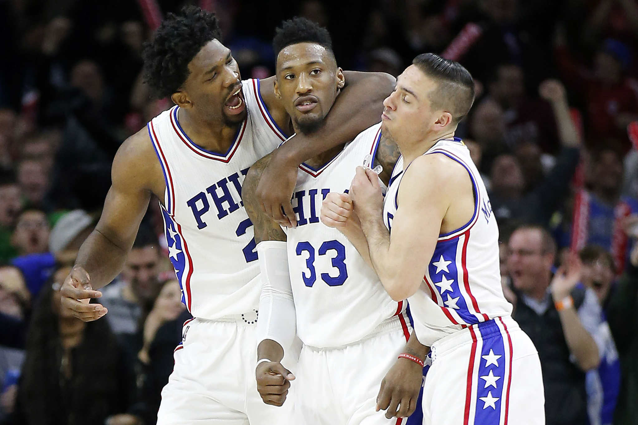 Sixers forward Robert Covington celebrates his game winning three-point basket with teammates Joel Embiid and T.J. McConnell against the Portland Trail Blazers on Friday, January 20, 2017.  YONG KIM / Staff Photographer