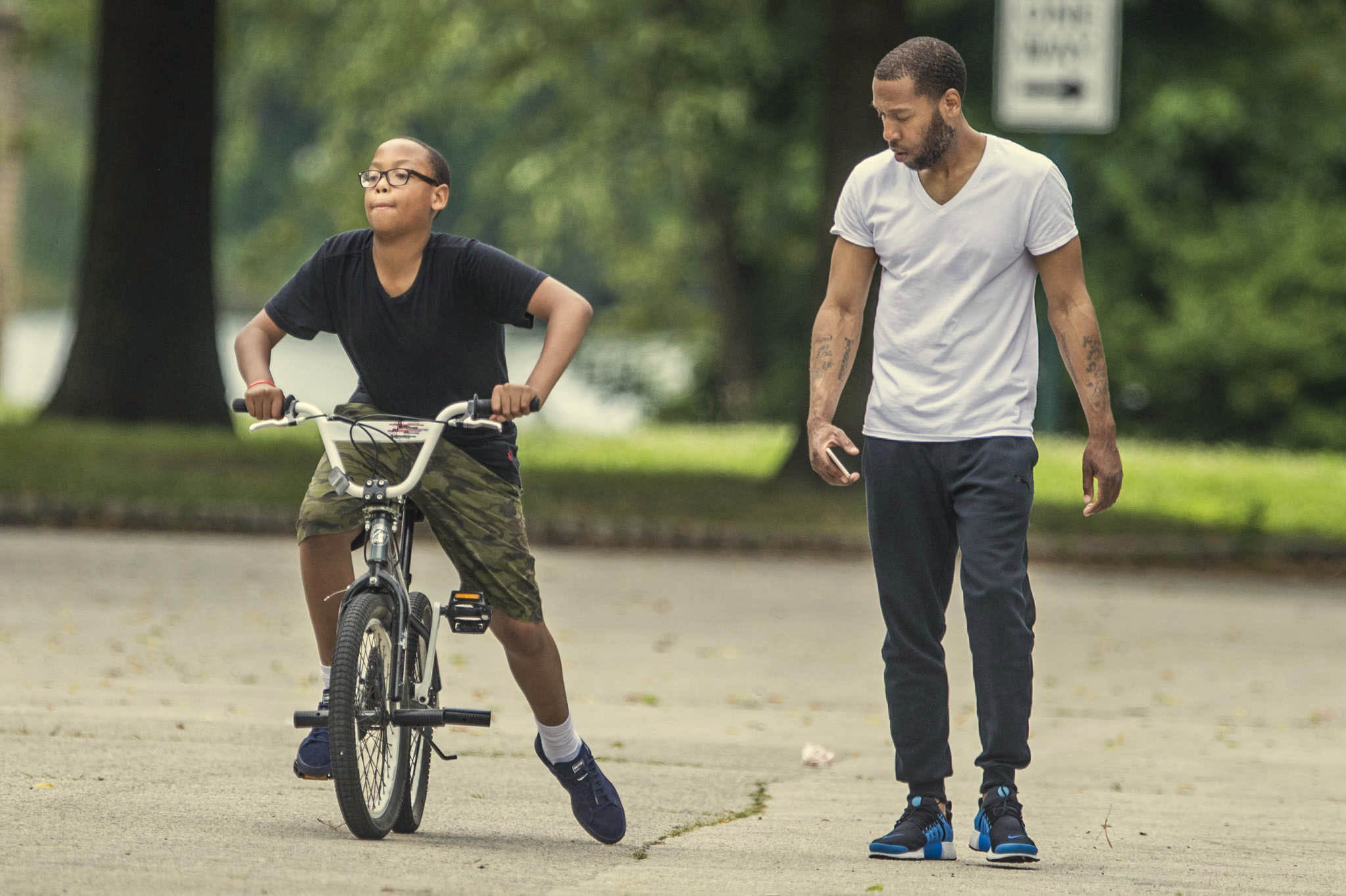 Tykee White Jr, is taught how to ride a bicycle by his father Tyree at FDR park in S. Philadelphia. MICHAEL BRYANT / Staff Photographer