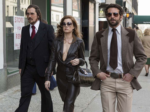 Christian Bale (left) as Irving, Amy Adams as Sydney, and Bradley Cooper as Richie DiMaso make Abscam-era fireworks.
