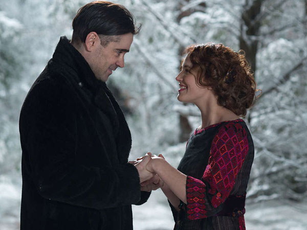 "Jessica Brown Findlay, right, and Colin Farrell in a scene from ""Winter´s Tale."" (AP Photo/Warner Bros., David C. Lee)"