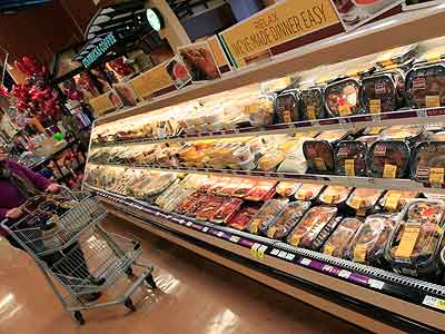 Teens eat the saltiest diet, and many of those culprit foods are found on supermarket shelves, including those that are stocked with foods designed to make our lives easier. (Al Behrman / AP)