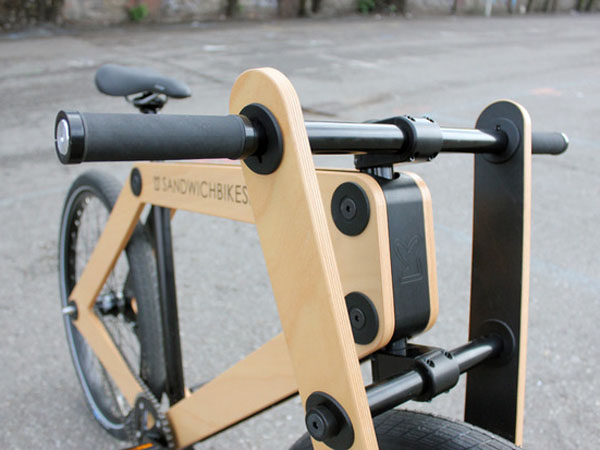 The unconventional Sandwichbike finds its form in two pieces of pressed plywood, which are connected by an array of custom-made components and a conventional single speed drivetrain.