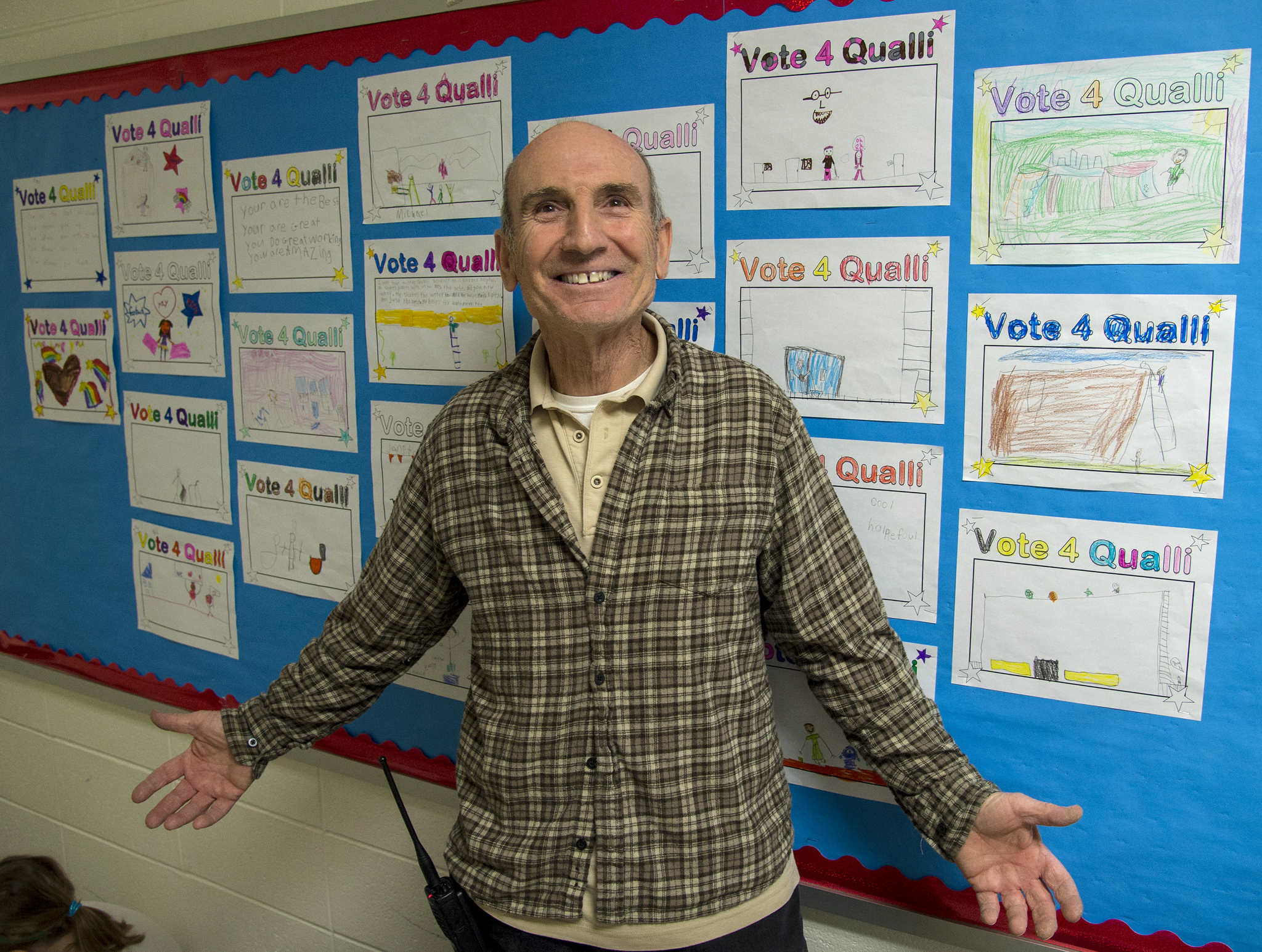 Ted Qualli, 66, beloved janitor at Newtown Elementary School in Newtown, Bucks County, stands in front of �Vote 4 Qualli� coloring sheets made by the first graders in support of Qualli�s bid to be named Janitor of the Year in a nationwide contest.