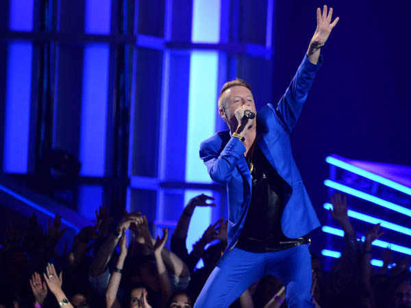 "Rapper Macklemore of Macklemore & Ryan Lewis, performing at the MTV Movie Awards in Sony Pictures Studio Lot in Culver City, Calif.  The song by Macklemore & Ryan Lewis feat. Ray Dalton, ""Can´t Hold Us,"" was the top streamed track on Spotify from Monday, May 27, to Sunday, June 2.  (AP Photo/ MTV, Jordan Strauss, file)"