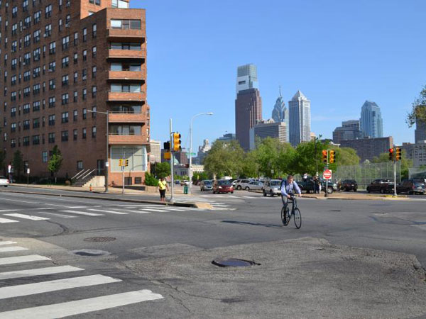 Improved markings will soon help bikers and pedestrians navigate from Spring Garden Street to the Schuylkill River, an initial step in plans for the Spring Garden Street Greenway. (PlanPhilly)