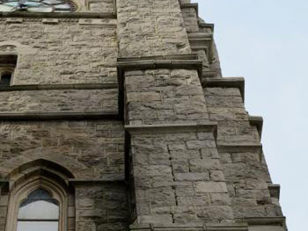 Cracks in the buttresses at St. John the Baptist in Manayunk are in urgent need of repair. (PlanPhilly)
