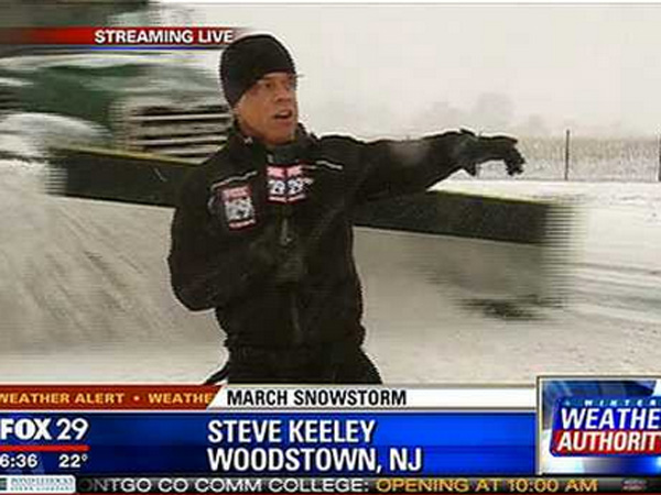 Fox29´s Steve Keeley almost gets hit by a snow plow.