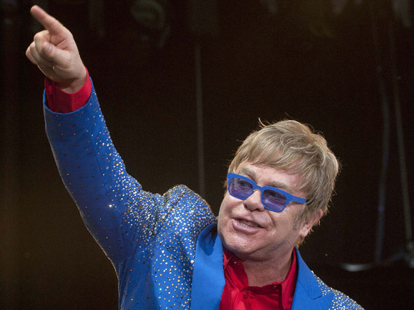 "British singer Elton John performs at the second edition of the open air festival ""Stars of Sounds Murten"", on Monday, June 17, 2013, in Murten, Switzerland. (AP Photo/Keystone, Sandro Campardo)"