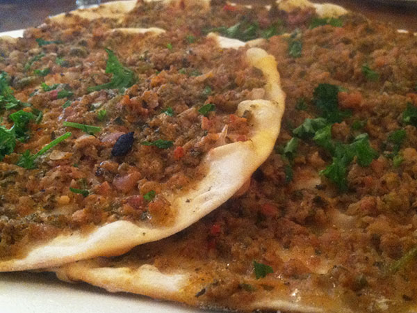 Turkish Lahmacun flatbreads topped with minced lamb from Leziz Turkish Cuisine. (Craig LaBan / Staff)