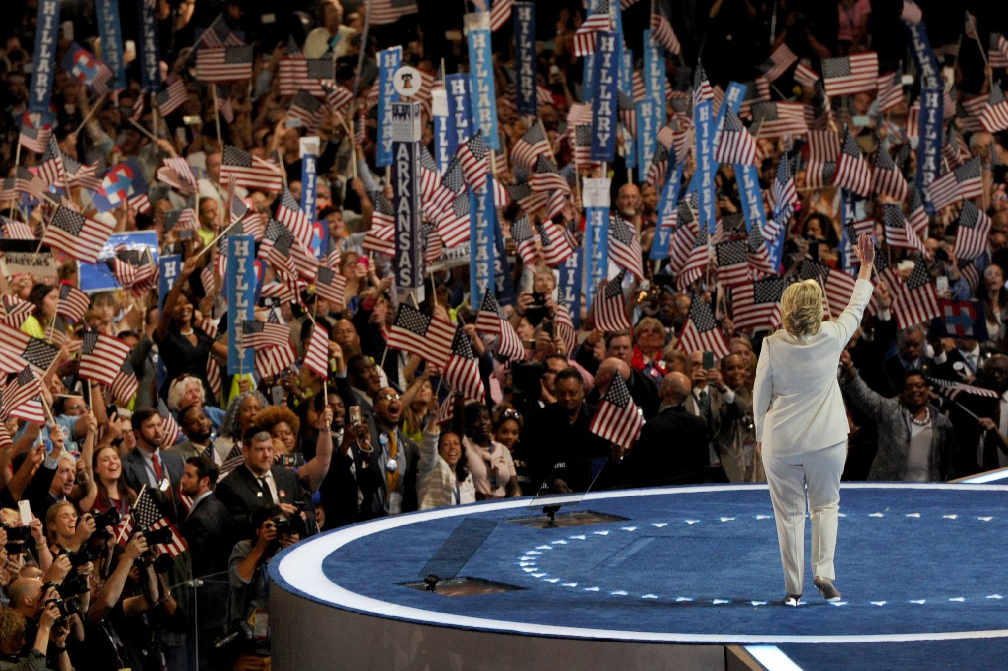July 28, 2016: Democratic presidential nominee Hillary Clinton walks on stage at the Wells Fargo Center to accept the nomination of her party on the final night of the DNC.